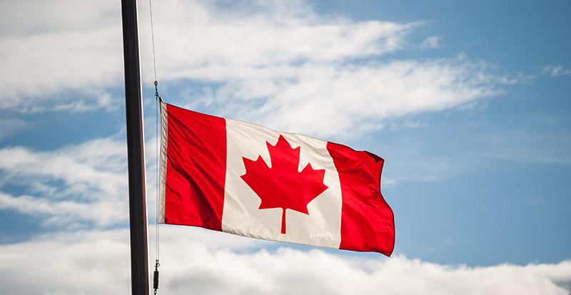 Canadian Flag Waving at Half-Mast